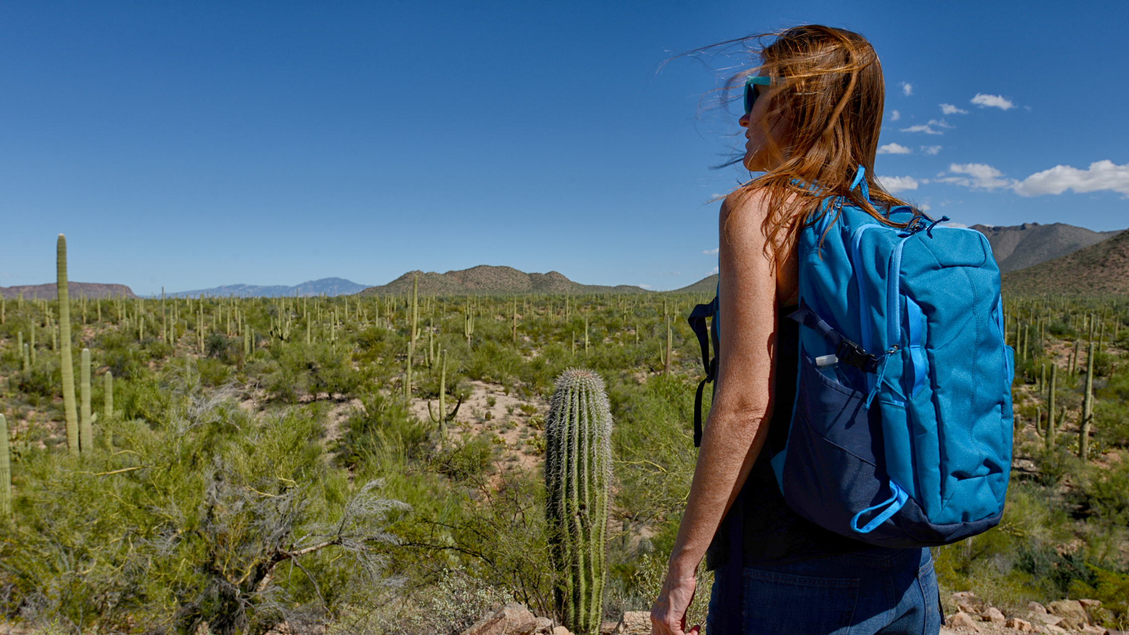 woman hiking in the desert